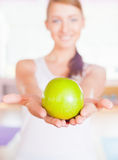 Healthy lifestyle concept with beautiful woman holdin green apple Stock Image