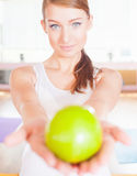 Healthy lifestyle concept with beautiful woman holding green apple Royalty Free Stock Photo