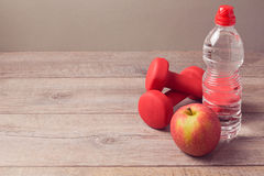 Healthy lifestyle concept with bottle of water and apple Royalty Free Stock Photography