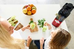 Healthy lifestyle Cute little girl mother drink healthy drink ce stock images