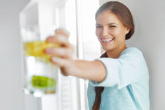 Healthy Lifestyle Concept, Diet And Fitness. Woman Drinking Wate. Healthy Lifestyle Concept, Diet And Fitness. Smiling Woman Drinking Refreshing Water With Fresh Stock Photography