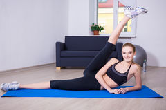 Healthy lifestyle concept - flexible woman doing stretching exer Stock Photos