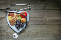 Healthy lifestyle concept with food on heart Royalty Free Stock Photo