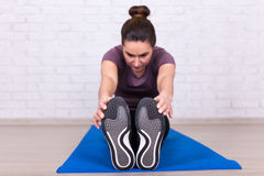 Healthy lifestyle concept - front view of woman doing stretching Royalty Free Stock Photos
