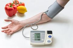 Healthy lifestyle concept. Man is measuring blood pressure with m Stock Photography