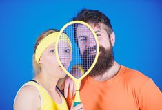 Healthy lifestyle concept. Man and woman couple in love with tennis racket sport equipment. Workout and fitness. Girl royalty free stock photo