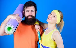 Healthy lifestyle concept. Man and woman couple in love with yoga mat and sport equipment. Fitness exercises. Workout royalty free stock image