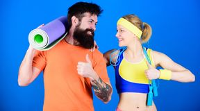 Healthy lifestyle concept. Man and woman with yoga mat and sport equipment. Fitness exercises. Workout and fitness. Girl stock photos