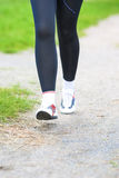 Healthy Lifestyle Concept: Runner's Legs Closeup Running On the Stock Images