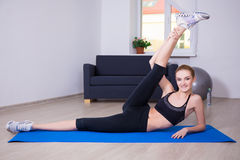 Healthy lifestyle concept - slim flexible woman doing stretching Stock Images
