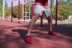 Healthy lifestyle concept. Training outdoors. Blurred background. stock image