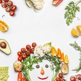 Healthy lifestyle concept. Various fresh vegetables with funny face made with ingredients on white background Stock Image