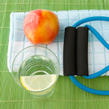 Healthy lifestyle concept - water, apple, expander Stock Photography