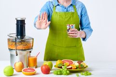 Healthy lifestyle detox diet concept. Fruit juice, pills and vitamin supplements. New year`s resolution stock image