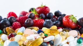 Healthy Lifestyle, Diet Concept, Fruit And Pills, Vitamin Supplements Royalty Free Stock Image