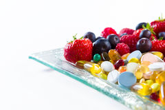Healthy lifestyle, diet concept, Fruit and pills, vitamin supplements Stock Images