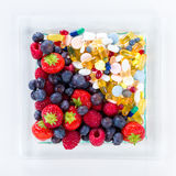 Healthy lifestyle, diet concept, Fruit and pills, vitamin supplements Royalty Free Stock Photography
