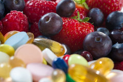 Healthy lifestyle, diet concept, Fruit and pills, vitamin supplements Stock Image