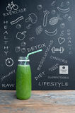 Healthy lifestyle and diet concept. Fruit and vegetable smoothie with sketched ingredients and lifestyle icons Stock Photo