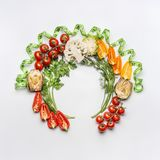 Healthy lifestyle and dieting concept. Round circle frame of various salad vegetables ingredients and greens on white desk backgro Royalty Free Stock Photo