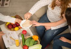 Healthy lifestyle explanation. Close up image of patient and dietitian. t and vegetables on table royalty free stock images