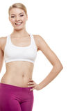 Healthy lifestyle. Fit fitness sport woman happy girl, studio shot Royalty Free Stock Image