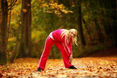 Healthy lifestyle. Fitness girl doing exercise outdoor Stock Photo