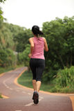 Healthy lifestyle fitness sports woman running leg Stock Images