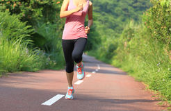 Healthy lifestyle fitness sports woman running leg Royalty Free Stock Photos