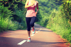 Healthy lifestyle fitness sports woman running leg Royalty Free Stock Images
