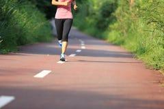 Healthy lifestyle fitness sports woman running leg Stock Photo
