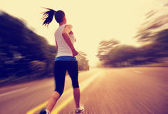Healthy lifestyle fitness sports woman running legs Stock Images