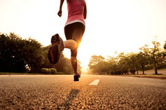 Healthy lifestyle fitness sports woman running. At sunrise road royalty free stock images