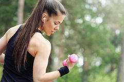 healthy lifestyle fitness sporty woman with dumbbell and headphone in beautiful nature area royalty free stock photography