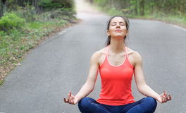 Healthy lifestyle fitness sporty woman have a meditation in the. Healthy lifestyle fitness sporty woman have meditation in the morning in forest area, healthy Royalty Free Stock Photography