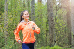 Healthy lifestyle fitness sporty woman running early in the morn Stock Image