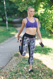Healthy lifestyle fitness sporty woman running early in the morning in park Stock Photos