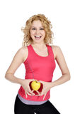 Healthy lifestyle - fitness woman hand apple Royalty Free Stock Photo
