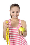 Healthy lifestyle - fitness woman hand apple Stock Photo