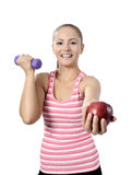 Healthy lifestyle - fitness woman hands apple Royalty Free Stock Photography