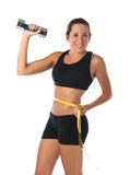 Healthy lifestyle. Fitness woman with a measuring tape Stock Photos