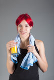 Healthy lifestyle - fitness woman with towel and juice smiling. Portrait of healthy lifestyle - fitness woman with towel and juice smiling royalty free stock photography