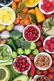Healthy Lifestyle Food. Concept with fresh vegetables, fruit, herbs, grains and nuts. Foods very high in antioxidants, omega 3, anthocyanins, minerals and Stock Image