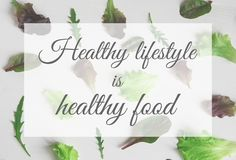 A healthy lifestyle is healthy food. The inscription on the background with salad and arugula. Healthy meal. A healthy lifestyle is healthy food. The inscription stock photos