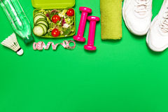 Healthy lifestyle, food, sport or athlete`s equipment on bright. Background. Flat lay. Top view with copy space Royalty Free Stock Images