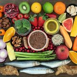 Healthy Lifestyle Food. Super food for a healthy lifestyle concept with foods high in omega 3 fatty acids, antioxidants, anthocyanins and vitamins with fresh Royalty Free Stock Images