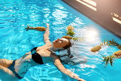 Healthy Lifestyle, Food. Young Woman In Pool. Fruits, Vitamins. Stock Photo