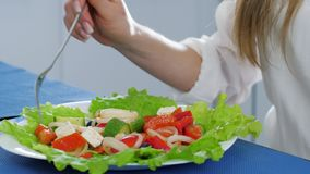Healthy lifestyle, fork into hands of man stirring vegetables in salad on table. Healthy lifestyle, fork into hands of man stirring vegetables in salad close-up stock video
