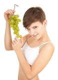 Healthy lifestyle - girl in sport bra with grapes Stock Images