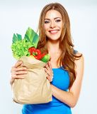 Healthy lifestyle with green vegan food. Young woman green diet. Concept. White background royalty free stock images